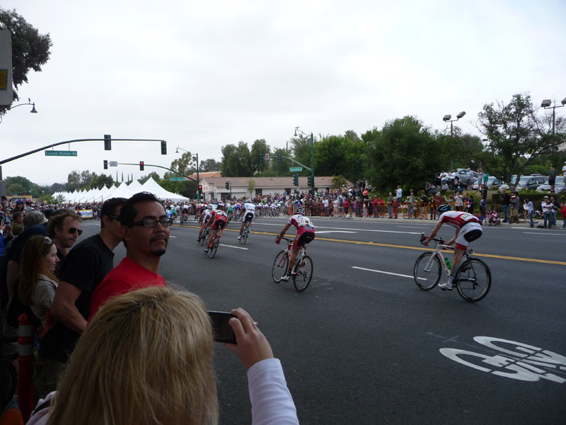 See of cyclists flying around the corner along the circuit.